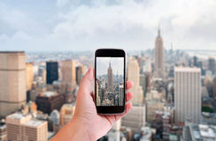 Hand with smartphone taken pictures of new york city Royalty Free Stock Photography