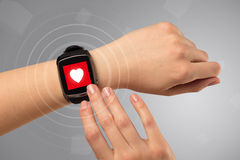 Hand with smartwach and helath concept. Naked female hand with smartwatch and with heart rate icon on the watch Royalty Free Stock Images