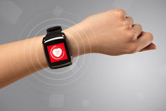 Hand with smartwach and helath concept. Naked female hand with smartwatch and with heart rate icon on the watch Stock Photography