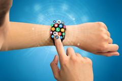 Smartwatch with application icons. Hand with smartwatch and application symbols nearby Stock Photos