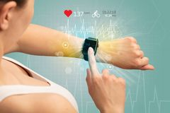 Cycle and smartwatch concept. Hand with smartwatch and cycling concept nearby Stock Photo