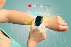 Cycle and smartwatch concept. Hand with smartwatch and cycling concept nearby Stock Photos