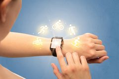 Hand with smartwatch. Female hand with smartwatch and sport concept Royalty Free Stock Photo