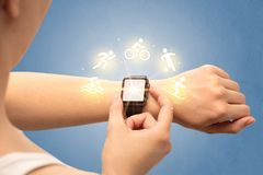 Hand with smartwatch. Female hand with smartwatch and sport concept Royalty Free Stock Photography