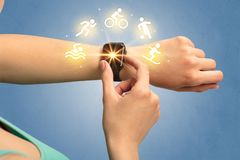 Hand with smartwatch. Female hand with smartwatch and sport concept Stock Image
