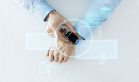 Hand with smartwatch and virtual screen projection Royalty Free Stock Images
