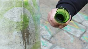 Hand with a smashed bottle. In autumn day stock footage