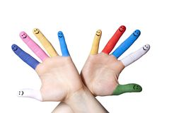 Hand with smiling fingers. A hand with colorful painted and smiling fingers royalty free stock photos