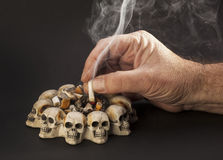 Hand with smoke cigarette. On dark background Royalty Free Stock Photography