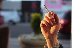 Hand with smoking cigarette Royalty Free Stock Images