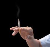 Hand smoking Stock Image