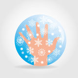Hand and snowflakes on blue Royalty Free Stock Photography