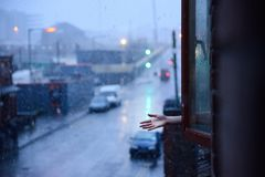 The hand in the snowing day in Dublin, Ireland. The hand through the window in the snowing day in Dublin, Ireland Royalty Free Stock Image