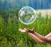 Hand with soap bubble Stock Photos