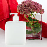 Hand soap with towel and flower Stock Photos