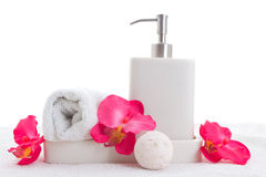 Hand soap, towel and pink orchid royalty free stock photos