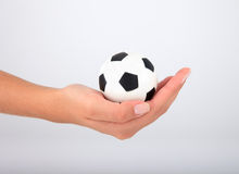 Hand with soccer ball Royalty Free Stock Image