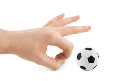 Hand and soccer ball Stock Images