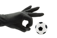 Hand and soccer ball. Hand in glove and soccer ball, isolated on white background Stock Photography