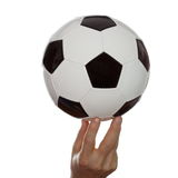 Hand with soccer ball stock photography