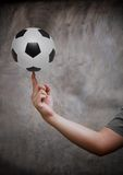 Hand and soccer football Royalty Free Stock Photography