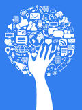 Hand social media tree. Hand tree with social media icons on blue background Royalty Free Stock Photo