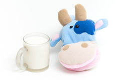 Hand soft toy cow. Soft hand puppet cow with glass of milk Royalty Free Stock Images