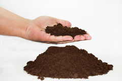 Hand with soil over soil in a pile Stock Images