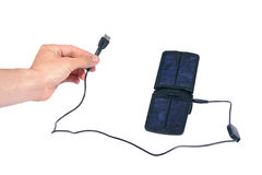 Hand and solar charger Royalty Free Stock Images
