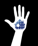 Hand with solar house. Royalty Free Stock Photos