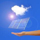 Hand with Solar Panel. Sunlight and blue sky background Royalty Free Stock Image