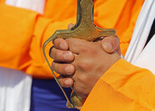 Hand of soldier and hilt of the sword. During the sikh event Royalty Free Stock Image