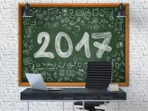 Hand som dras 2017 på den svart tavlan för kontor 3d Arkivbild