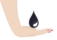 Hand som fångar svart droppe Fotografering för Bildbyråer