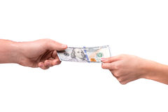 Hand som ger dollaren till annan person Royaltyfri Bild