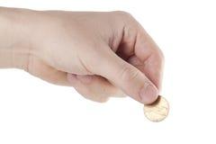Hand som håller myntet Arkivfoto