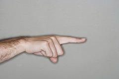 Hand som pekar med pekfingret fotografering för bildbyråer