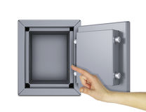 Hand som pekar till det öppna kassaskåpet Fotografering för Bildbyråer