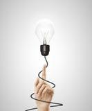 Hand som pekar till lampan Arkivfoton