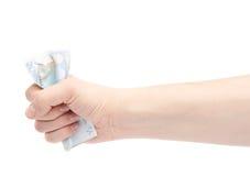 Hand som pressar anmärkningen för euro tjugo Arkivbilder