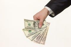 Hand som räcker över pengar på vit bakgrund royaltyfri foto