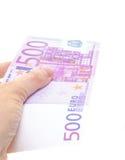 Hand som rymmer anmärkningen för euro 500 Royaltyfria Bilder