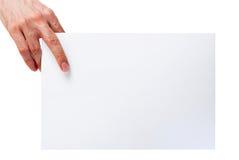 Hand som rymmer arket för tomt papper royaltyfri fotografi