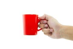 Hand som rymmer den röda koppen Royaltyfri Bild