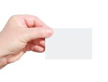 Hand som rymmer det blanka affärskortet Royaltyfria Foton