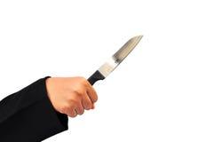 Hand som rymmer en kniv arkivfoto