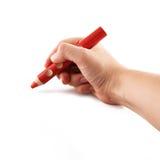Hand som rymmer en röd blyertspenna Royaltyfri Fotografi