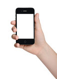 Hand som rymmer en svart telefon royaltyfri foto