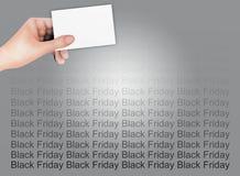 Hand som rymmer ett blankt kort på den svarta fredagen Backgrou Royaltyfri Bild
