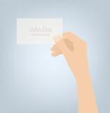 Hand som rymmer illustrationen för kort för personlig affär Arkivfoto